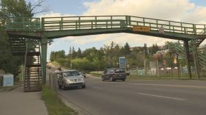 Pedestrian bridge over 14 Street in northwest Calgary changing to at-grade crossing