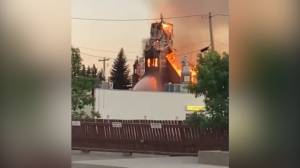 Cellphone video captures fire which consumed St. Jean Baptiste Parish Church in Morinville, AB (00:46)