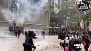 Hong Kong police force man to the ground during universal suffrage protests