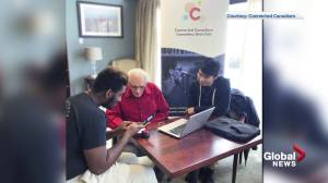 Tech-savvy volunteers show 'whole new world' to seniors on their cellphones and computers (01:39)