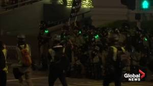 Hong Kong protesters met with tear gas by police on Christmas eve