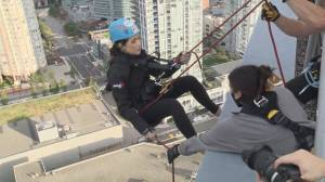 Yvonne Schalle rappels down Burnaby's Metrotower for Easter Seals BC (01:18)