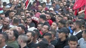 Funeral procession held for Palestinian allegedly killed by Israeli gunfire at West Bank (01:01)