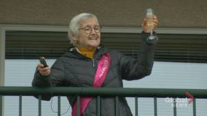 Calgary widow grieving loss of twin sister celebrates 82nd birthday from her balcony