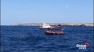 Migrants rescued after jumping from stranded rescue ship off southern Italian island