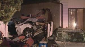 Edmonton police investigating after vehicle crashes into multiple homes