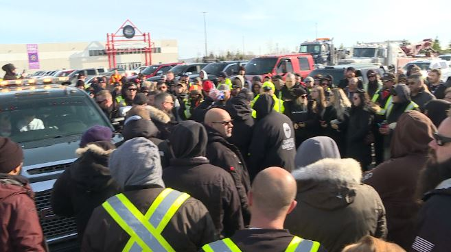 Hundreds of tow truck drivers pay their respects to driver killed on the job in Ontario