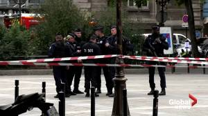 Police guard scene after man attacks officers with knife at Paris police HQ