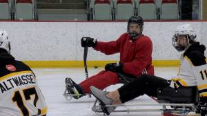 Injured Bronco Ryan Straschnitzki teaches lessons on and off the ice