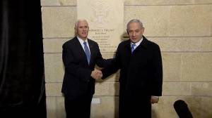 Pence, Netanyahu shake hands outside new U.S. embassy in Jerusalem