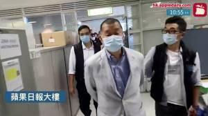 HongKongpolice arrest media tycoon, raid Apple Daily newsroom