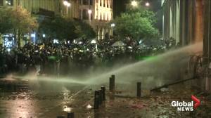 Water cannons fired at stone-throwing protesters in Beirut