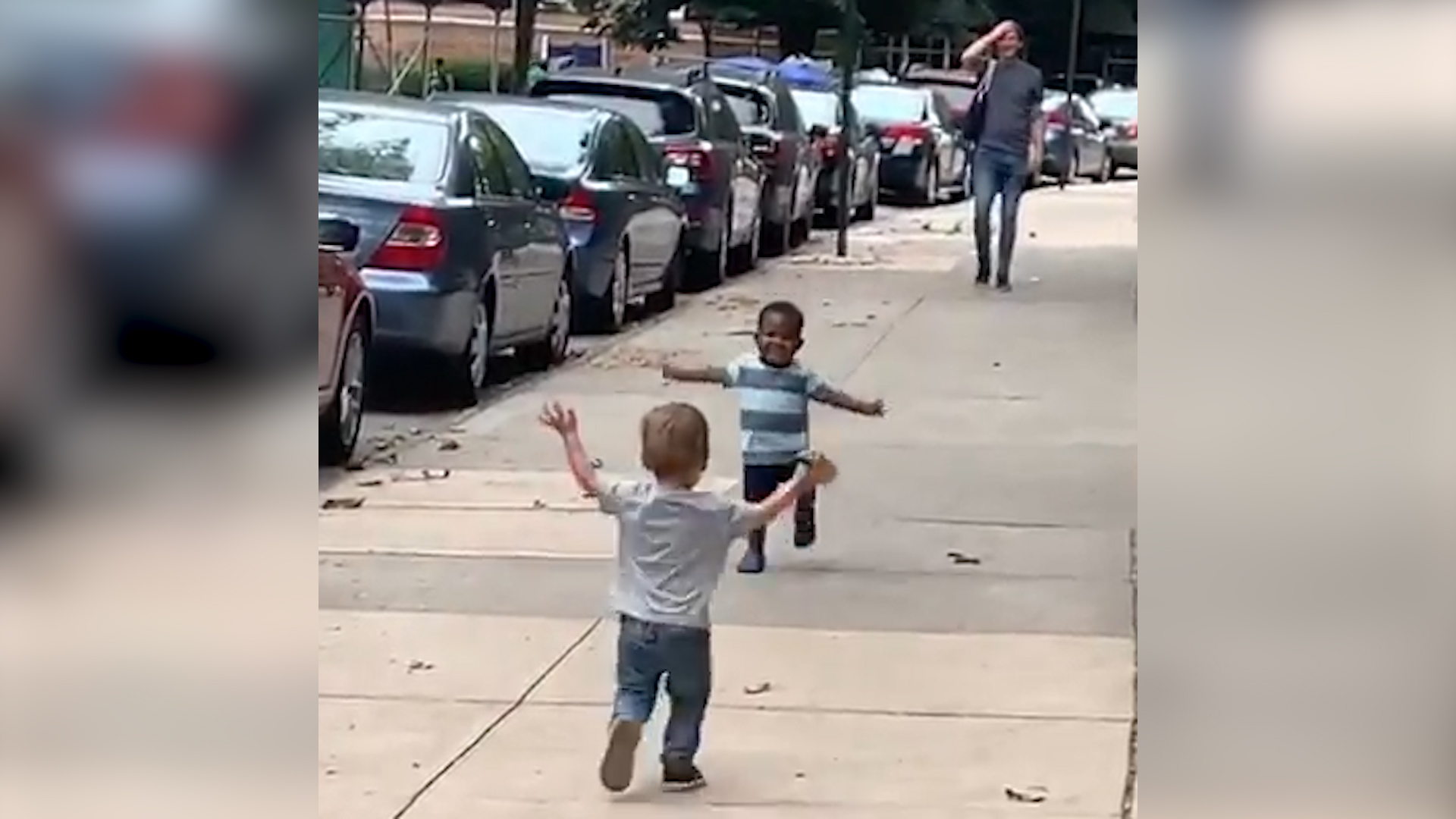 a black and a white kid running towards each other with open arms goes viral