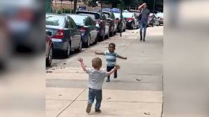 A Black and a white kid running towards each other with open arms goes viral (00:38)