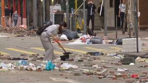 Hong Kong residents clean up after another night of protests