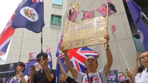 Hong Kong protesters march, sing in plea for British support