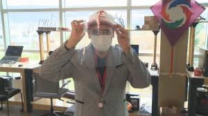 Coronavirus: University instructor designs device to adapt face shields to baseball hats (02:14)