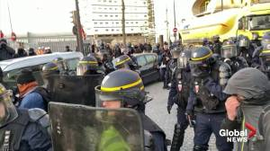 Police use tear gas to lift blockade on Paris waste disposal centre on day 42 of strikes