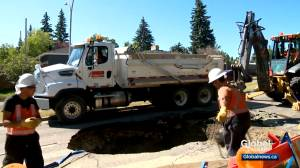 Water main break causes large sinkhole in southwest Calgary