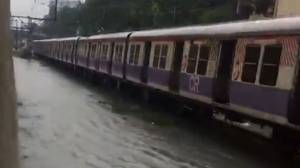 Train attempts to move through floodwaters in Mumbai