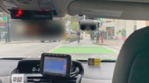 Police investigating video of taxi in bike lane