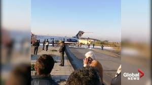 Iran passenger plane crash-lands on runway, skids onto highway