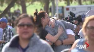Students are reunited with their parents after school shooting in California