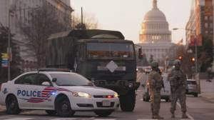 Security threat rains on D.C.'s typical inauguration celebrations, economy (02:56)