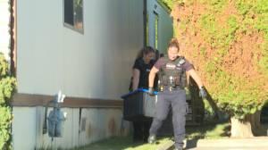Two dozen guns seized under search warrant connected to Kelowna murder investigation