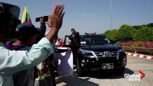 Thousands of supporters greet Suu Kyi on return to Myanmar