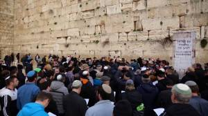 Coronavirus outbreak: Hundreds hold mass prayer at Jerusalem's Western Wall for those impacted