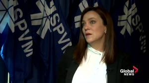 Detective Line Lemay of the Montreal police hate crimes unit talks to reporters