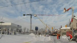Kingston firefighters continue dousing hotspots, crane stability questioned after