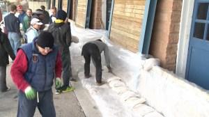 Sandbagging begins on riverside properties