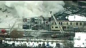 Aerial footage of Minneapolis apartment on fire after explosion