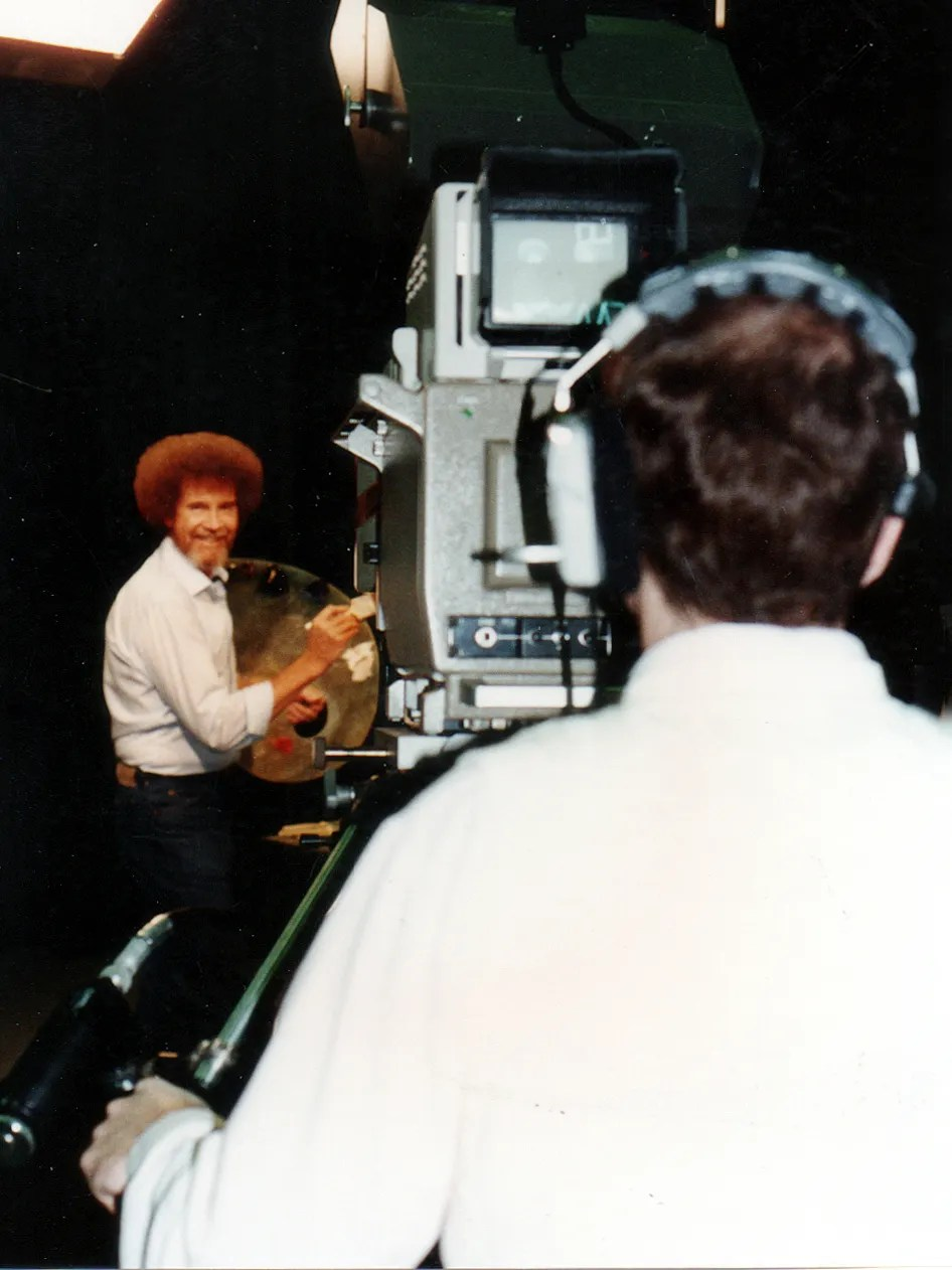 bob ross looking fly on camera