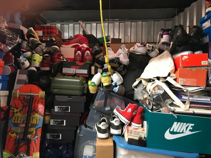 a storage unit with piles of sneakers and boxes