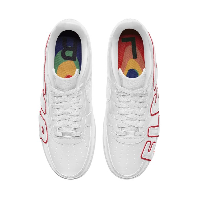 a white pair of Nike x CPFM air force one sneakers with red text on a white background