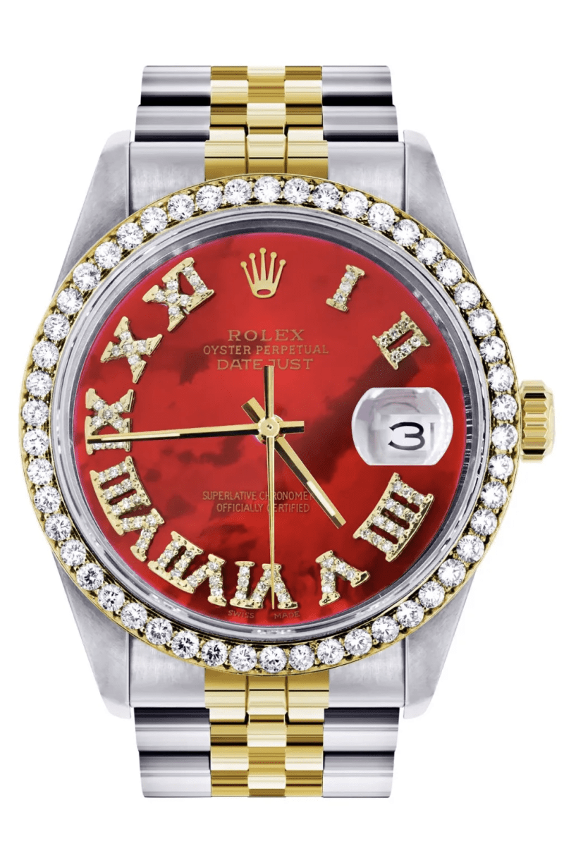 a chrome watch with a diamond dial and red face
