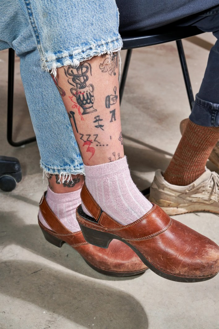 Image may contain Clothing Apparel Skin Human Person Shoe Footwear and Tattoo