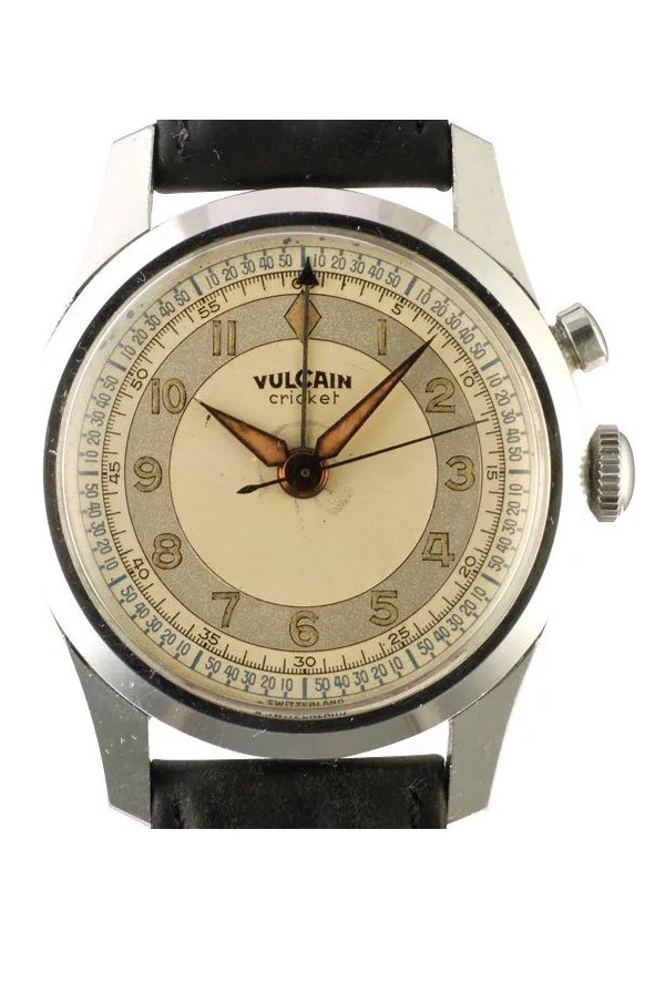 A silver watch with a tan paper face