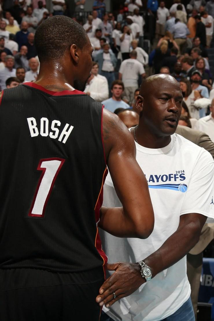 Michael Jordan dapping up Chris Bosh