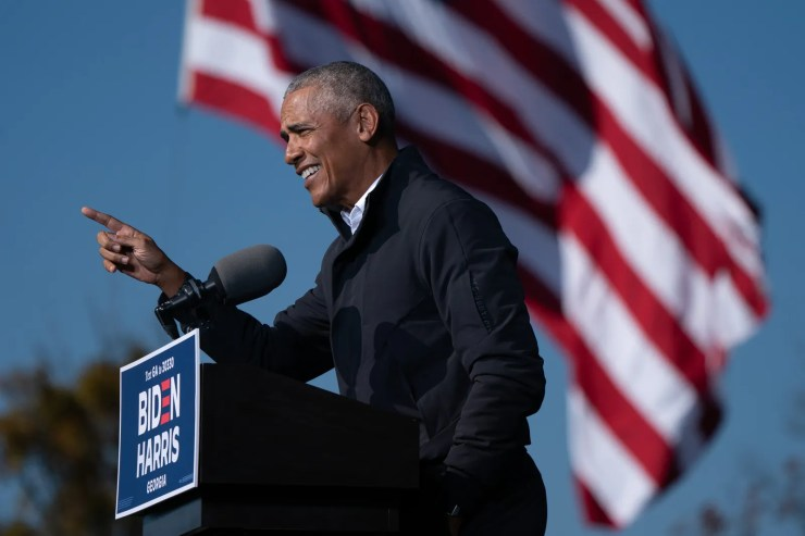 Former US President Barack Obama speaks at a Get Out the Vote rally as he campaigns for Democratic presidential...