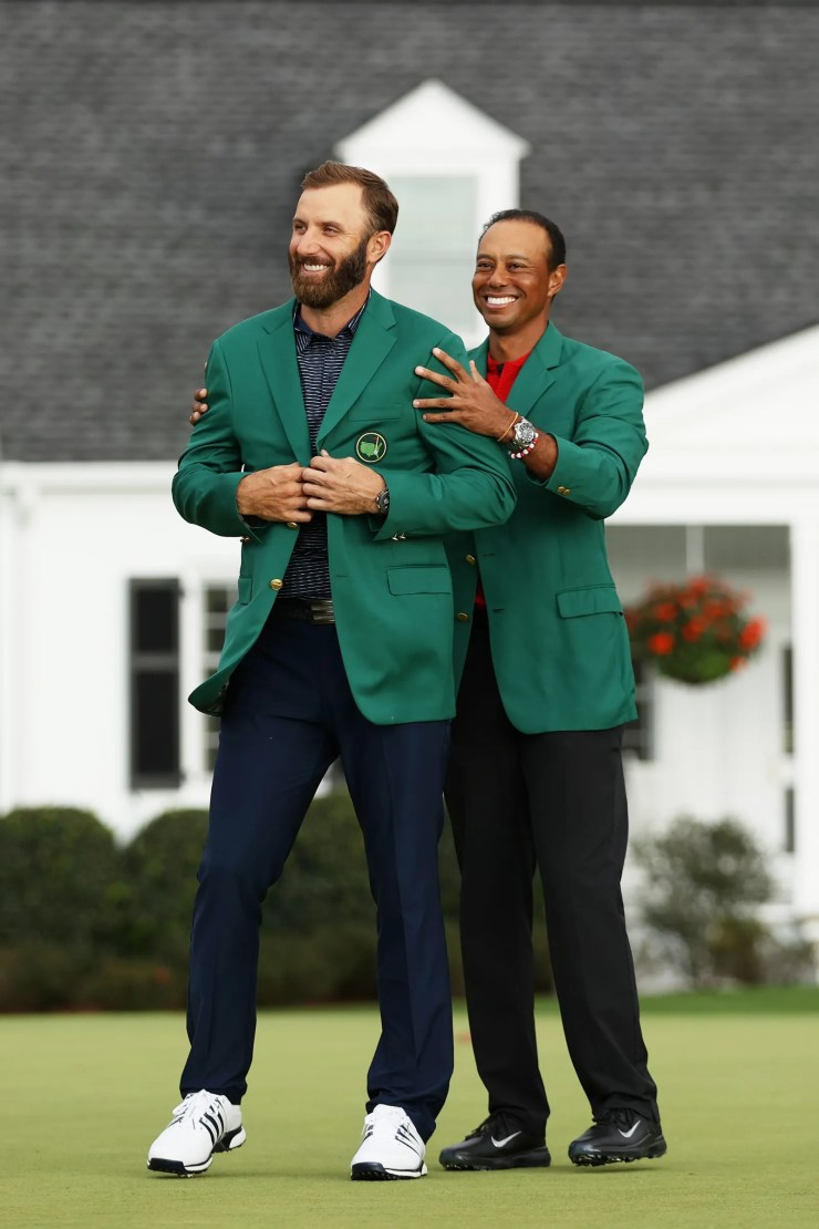 Tiger Woods and Dustin Johnson celebrating at the Masters