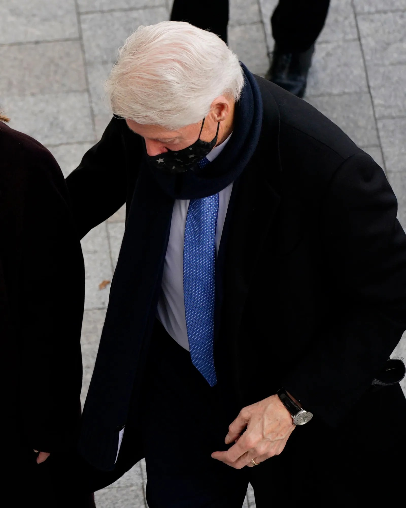 Bill Clinton walking up some steps