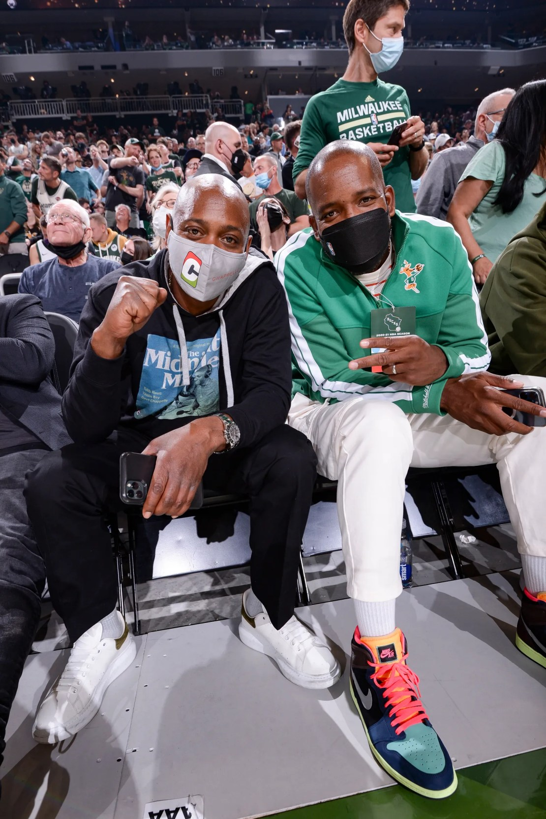 Dave Chapelle and Milwaukee Bucks Legend Michael Redd pose for a photo before the game between the Phoenix Suns and...