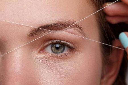 hårborttagning ansikte tråd