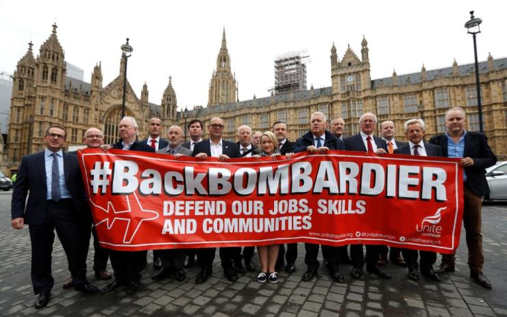 Members of Britain's Unite trade union protest outside the Houses of Parliament in support of Bombardier workers in London.