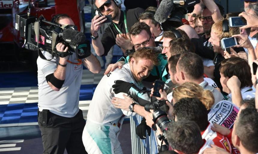 Mercedes AMG Petronas F1 Team's German driver Nico Rosberg (L) celebrates with his team members after winning the Formula One Australian Grand Prix in Melbourne.