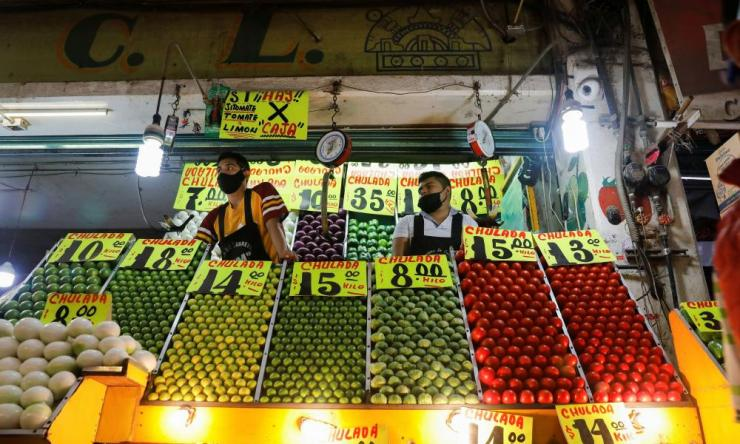 Vendors are pictured at Central de Abastos, one of the world's largest wholesale market complexes, as the coronavirus outbreak continues in Mexico City, Mexico 13 July 2020.